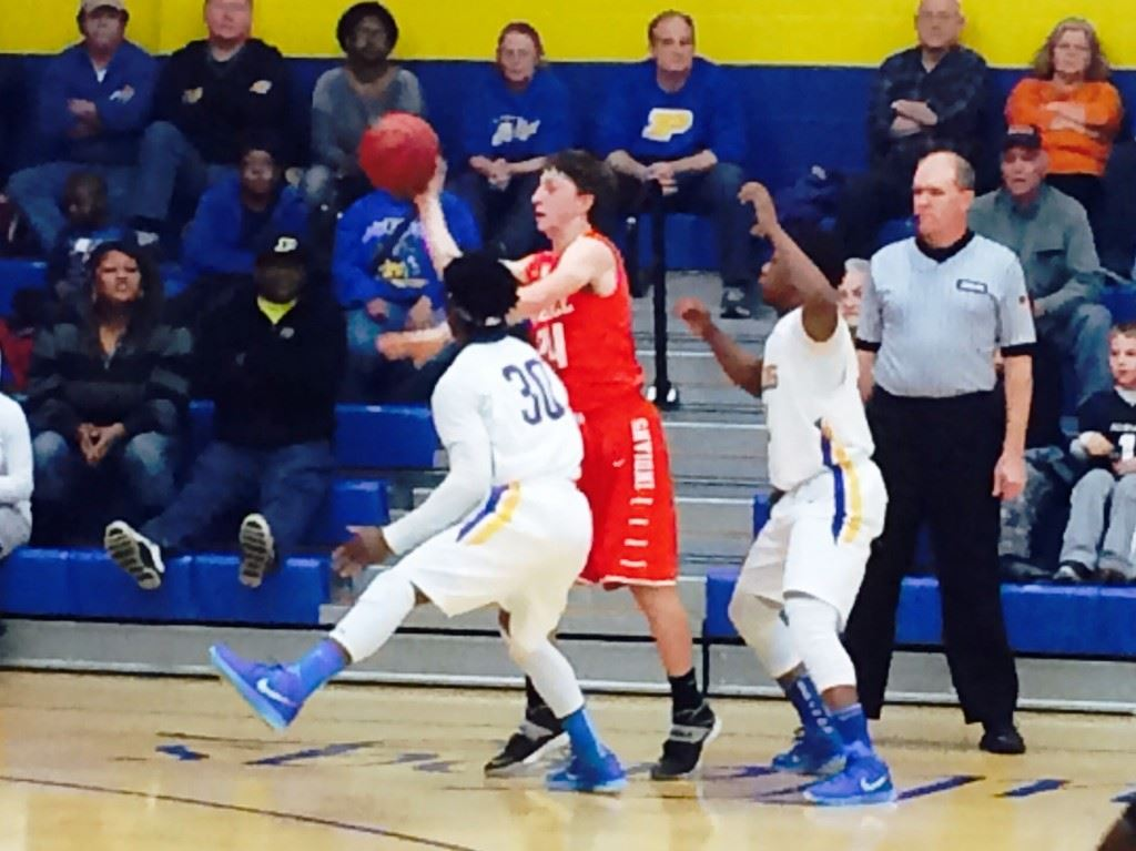 Piedmont's C.J. Savage (30) and Darnell Jackson turn up the heat on Ohatchee's Austin Tucker Tuesday night. The Bulldogs' press forced numerous turnovers they turned into baskets.