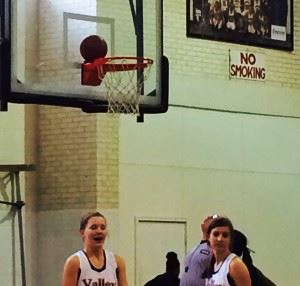 Alexandria's (from left) Timberlyn Shurbutt and Molly Parker wonder what's next after the ball balances on the back rim during their area tournament game Tuesday. On the cover, Connieya Bradford (right) played a big role in helping the Cubs grab the halftime lead.