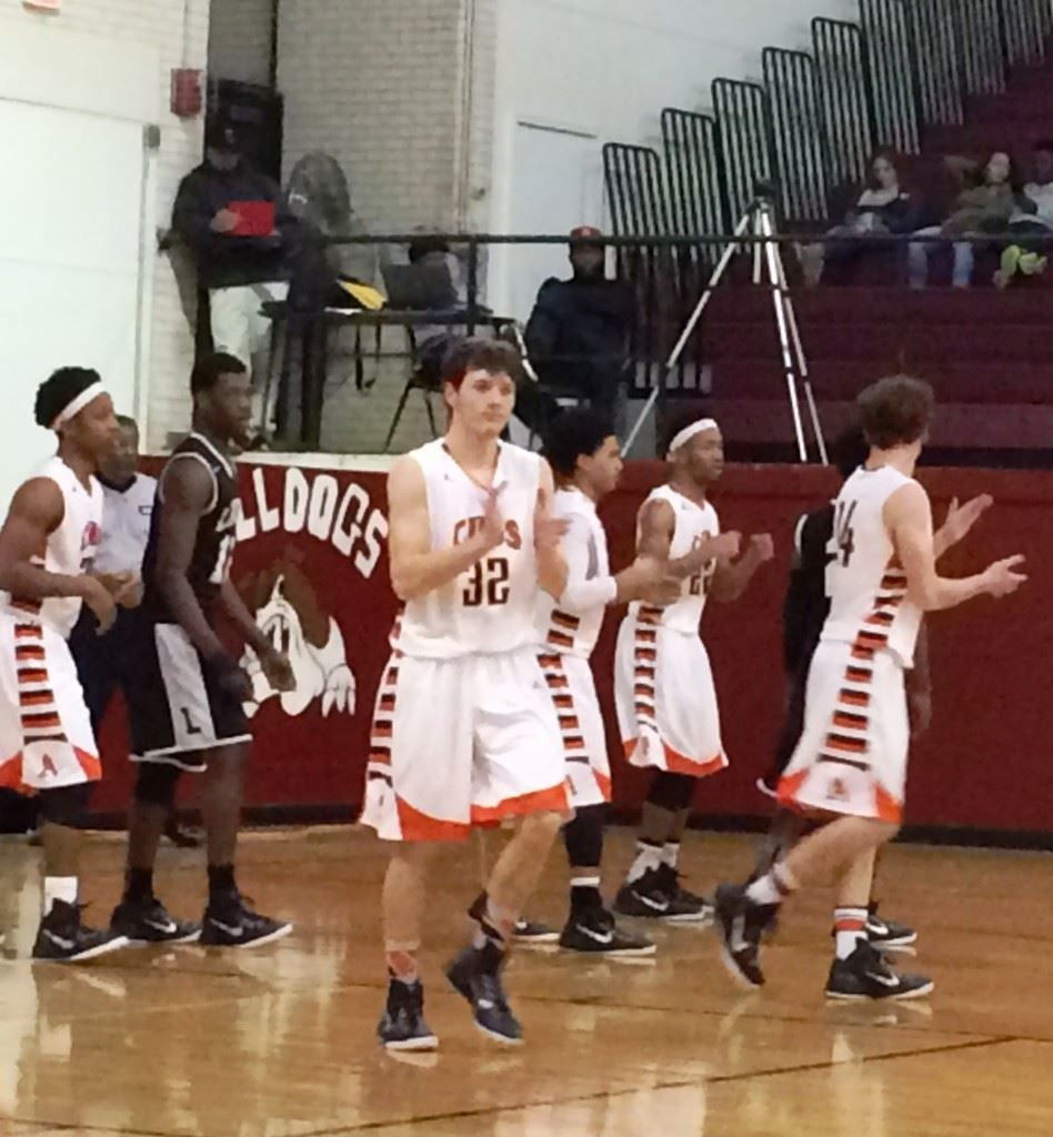 Dakota Kelley (center) leads his Alexandria teammates back down the floor after a turnover in their area tournament game with Lincoln.