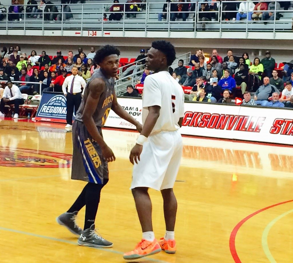 TCC's Crystyle Stockdale and Sacred Heart's D.J. Heath (5) face up during Tuesday's game. Stockdale scored 30 points and Heath was named tournament MVP.