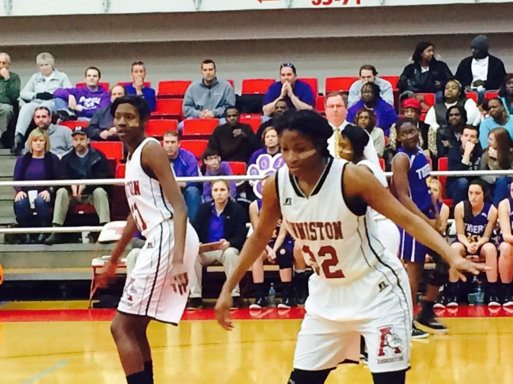 Anniston's Carsheuna Curry (32) and Takia Shears take their defensive stance against Springville.