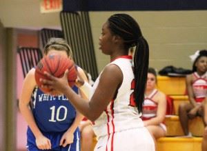 Saks' Miracle Dennard lines up a free throw Wednesday. (Photo by Bridget Merriman)