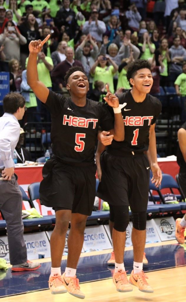 D.J. Heath (5) and Diante Wood erupt off the bench in the closing seconds of Sacred Heart's win in the state championship game. (Photo by Kristen Stringer/Krisp Pics Photography)