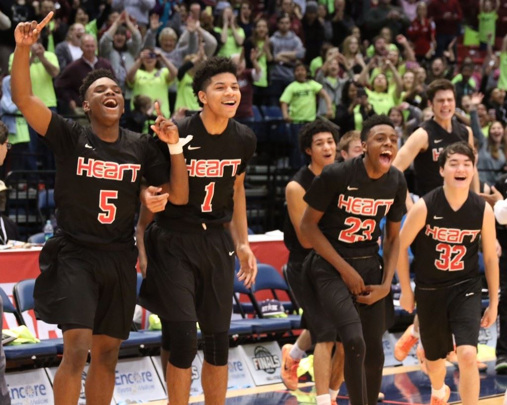 Sacred Heart players DJ Heath (5), Diante Wood (1), Kevion Nolan (23) and Tucker Norman (32) erupt off the bench as final seconds wind down in the Class 1A boys state championship game. (All photos by Kristen Stringer/Krisp Pics Photography).