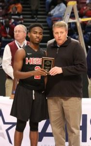 Kavarri Ross collecting his tournament MVP award.
