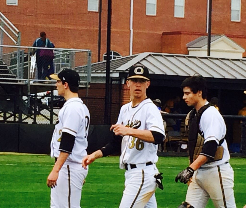Sophomore catcher Derek Miller (R) comes off the field with Mason Wilkins (L) and Andy Hammond after Oxford blanked Piedmont 4-0.
