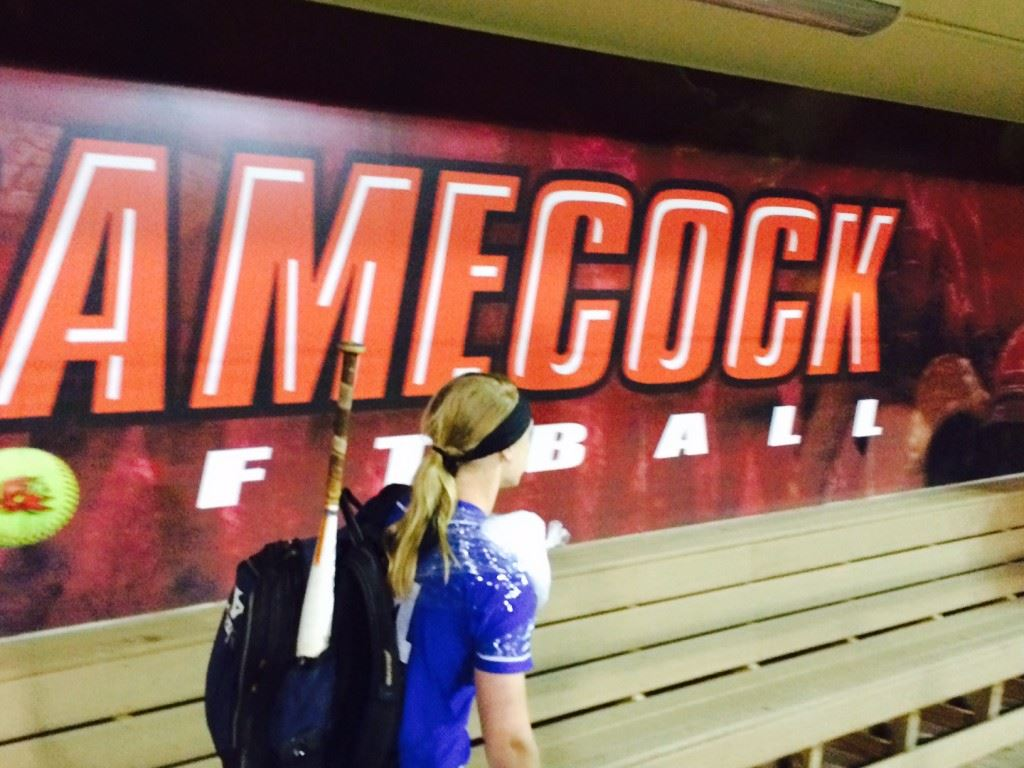 White Plains' Anna Snider leaves the Jacksonville State dugout after the Wildcats' games there Monday. The next time she's in that dugout she'll be playing for the Gamecocks.
