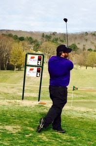Caleb McKinney watches his drive fly down the fairway at Anniston Municipal Saturday.