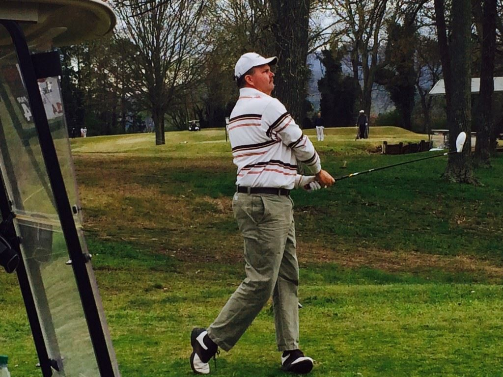 King of the Hill champion Gary Wigington follows his drive off the 14th tee Sunday.