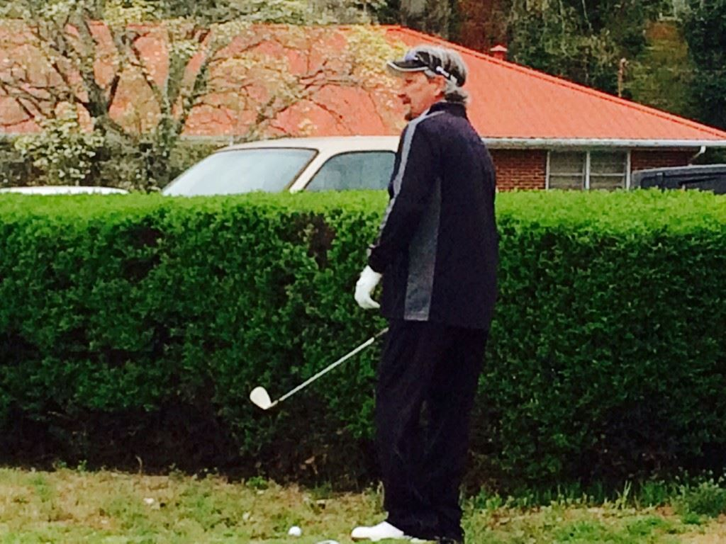 Jimbo Phillips contemplates his options from a tight spot near the 18th green Sunday.