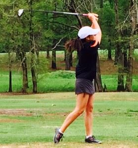 Alexandria's two-time defending champion Jordan Gregoria holds the finish on her first drive of the round Friday.