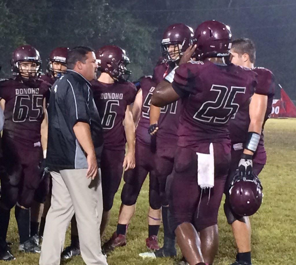 Andy McWilliams talks things over with the Donoho defense during a game last season. He was promoted to head coach Friday.