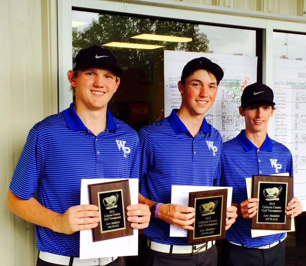 The top three medalists in the Calhoun County Boys Championship (from right): winner Dustin Travis, runner-up Layton Bussey and third-place Dylan Griggs.