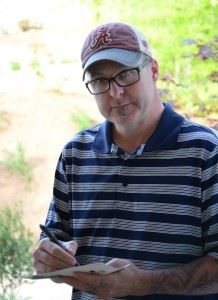 Ted Saylor rechecks his scorecard after Sunday's round in the Cider Ridge Invitational. (Photo by B.J. Franklin)