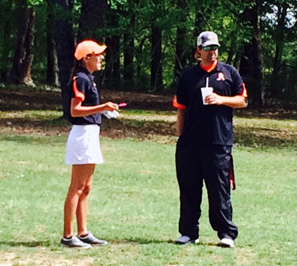Alexandria's Katie Roberts (L) gets some advice from Cubs coach Scott Ginn during the girls County Championship earlier this season.