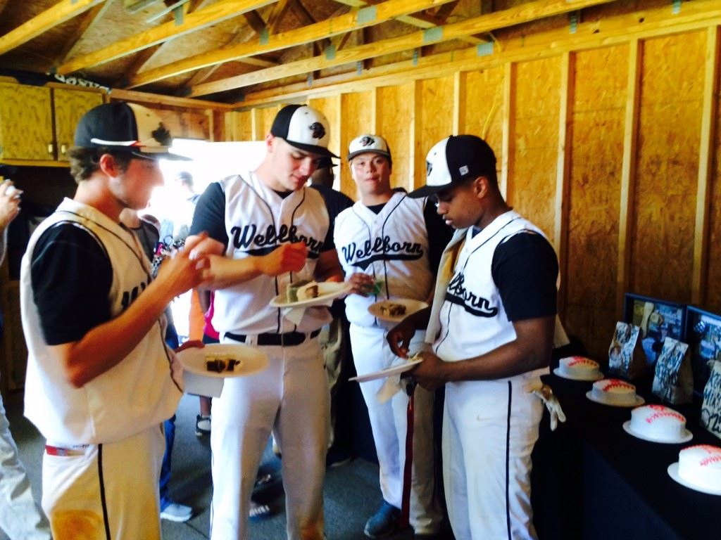 Wellborn's Mason Screws, Landon Machristie, T.J. Salers and Kevin Mixon all enjoy the trappings of a Senior Day celebration Friday. Below, Jeremiah Farmer steps up for a piece of cake that honors the Panthers' senior baseball players.