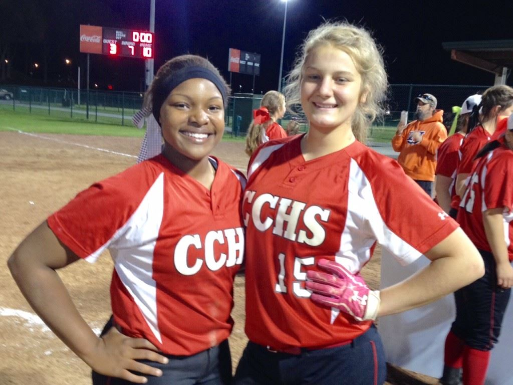 Cleburne County's Kiara Akles (L) won three games in the circle and had three hits in the championship game, while Chelsea Parker had three hits in the finals and the game-winning hit in the semis. On the cover, the Tigers celebrate victory.