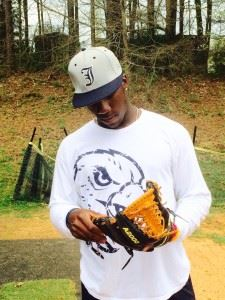 Former Jacksonville standout Shed Long checks out the glove he'll be using in his transition to second base at extended spring training with the Reds.