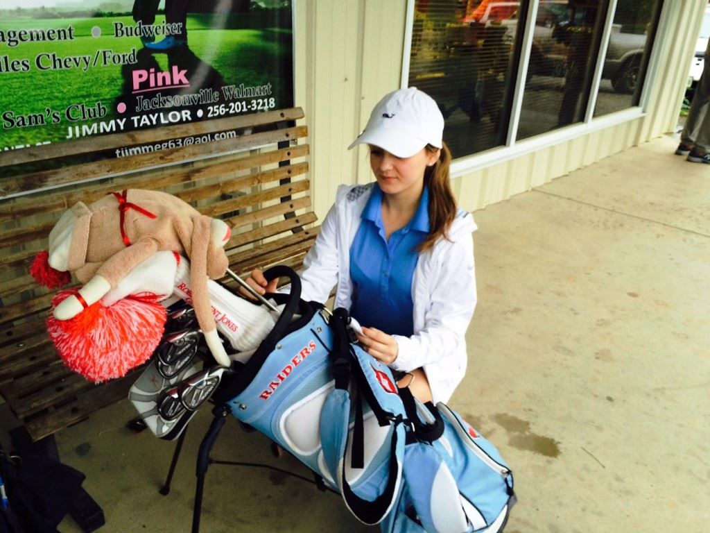 Pleasant Valley junior Madilyn Turner packs her gear after Friday's first round was suspended until later in the day.