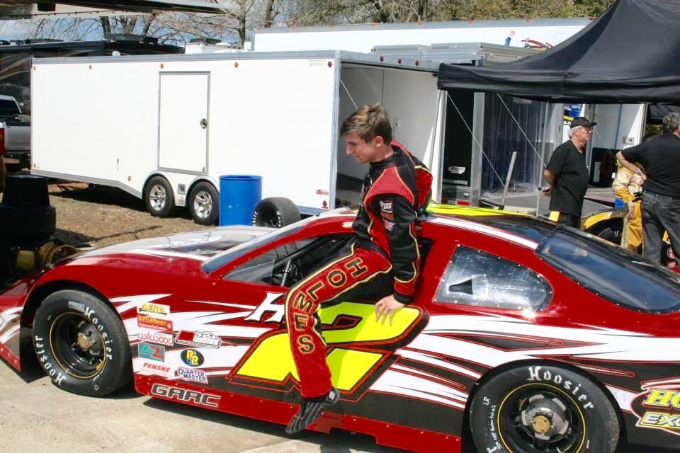Bret Holmes climbs into his car during a recent race. On the cover, Holmes talks about his two passions -- baseball and racing -- after Donoho's game Monday against JCA. (Car photo courtesy Bret Holmes)