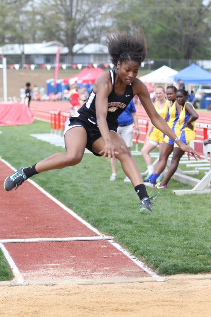 Carsheuna Curry played a key role in Anniston winning the County Girls Track title with wins in all three jumps. On the cover, Anniston's 4x400 relay team clinched the victory. (Photos by Kristen Stringer/Krisp Pics Photography).