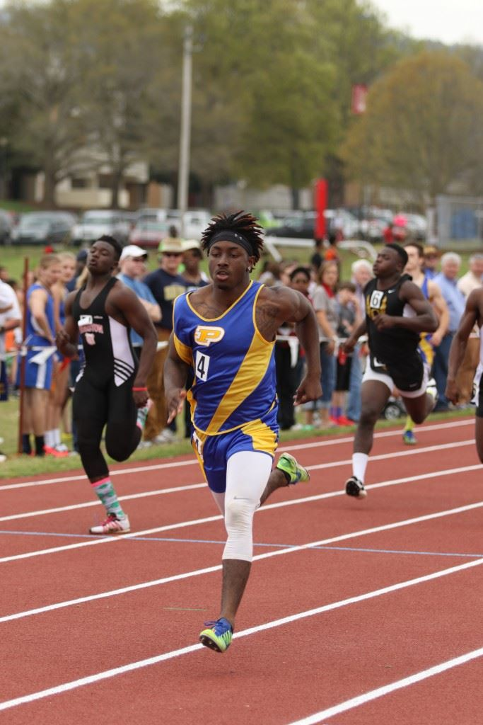 Piedmont's C.J. Savage races to the wire for one of his two sprints wins Tuesday. (Photos by Kristen Stringer/Krisp Pics Photography).
