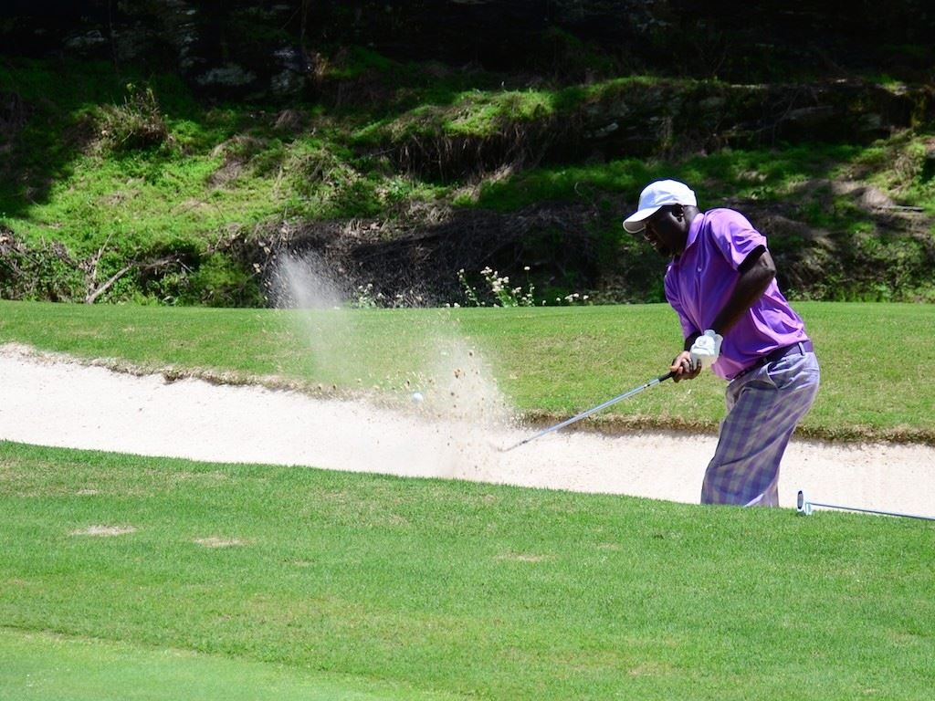 Maurice Dates of Talladega blasts out of the greenside bunker on 14 during play in the third flight Sunday.