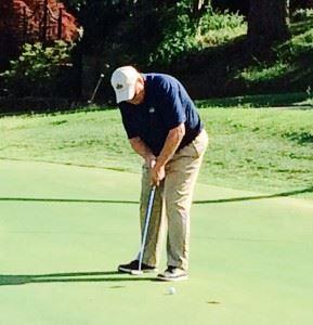 Cider Ridge director of golf Doug Wert sinks a putt on the 16th green Saturday.