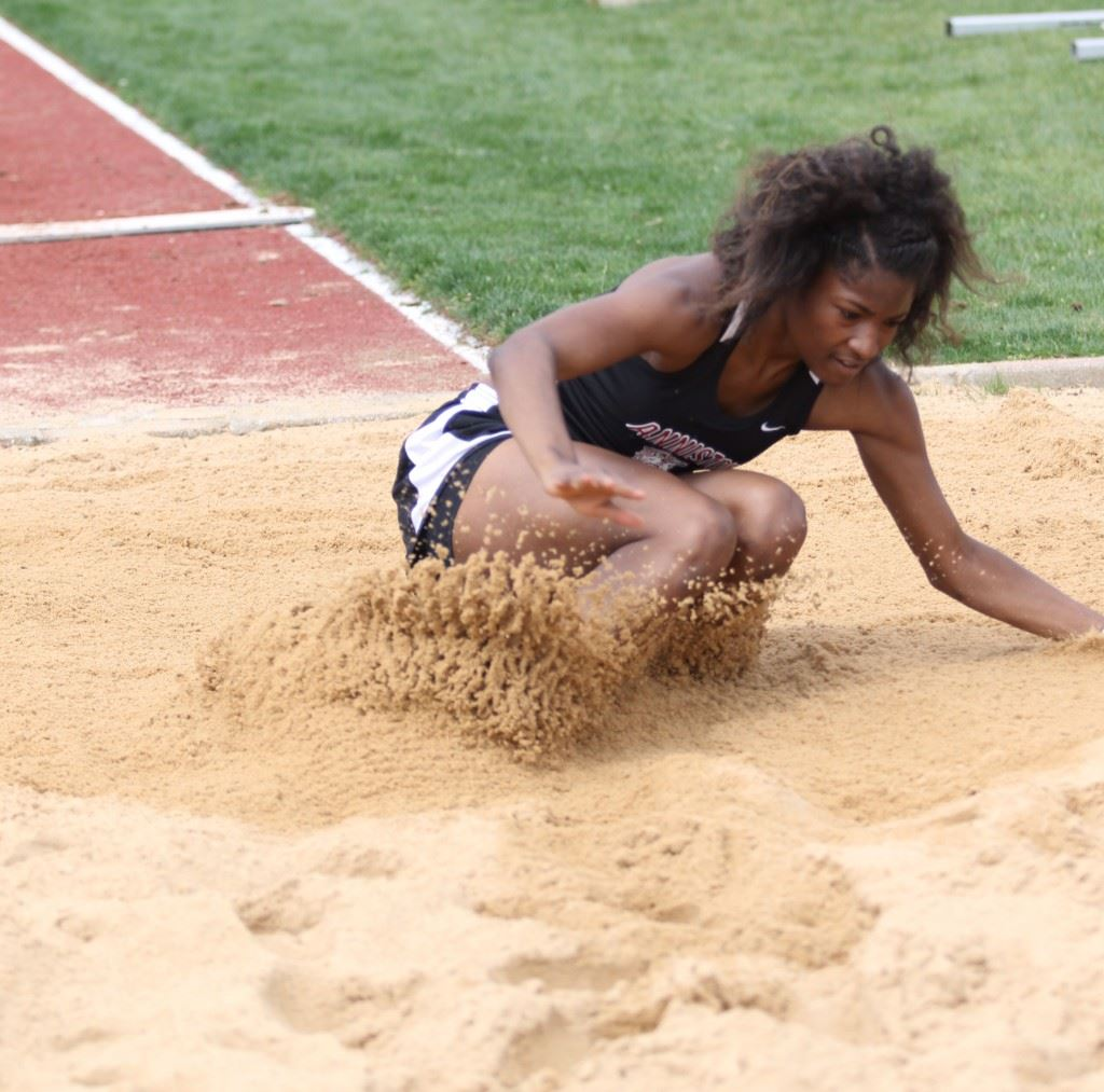 Anniston's Carsheuna Curry lands in the pit after a long jump at the Calhoun County Meet earlier this year. Curry won the 5A state title Wednesday. (Photo by Kristen Stringer/Krisp Pics Photography)
