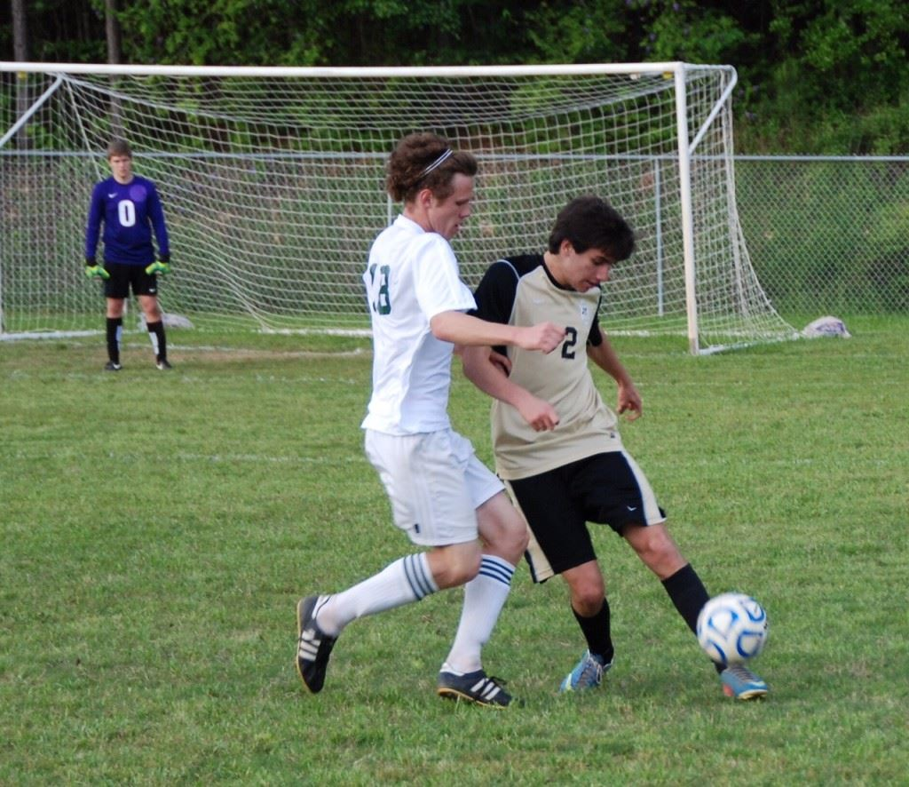 Faith senior midfielder Andrew Gattrell (18) marks an Altamont striker in an earlier playoff game. It's been said as Gattrell goes, so goes the Lions. (Photos by Tony Bedford).