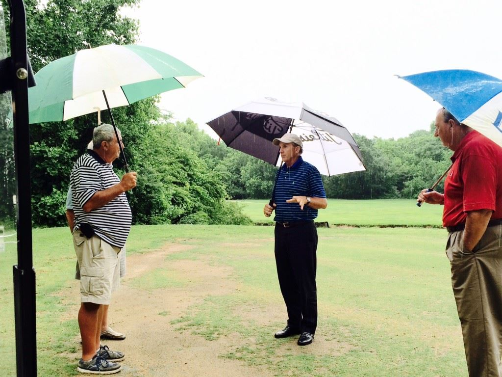 Former U.S. Open champion and Anniston resident Jerry Pate (C) gives Indian Oaks owner Ronnie Cofield (L) and pro shop manager Ron McClellan his opinion of the course's troubled No. 5 green.