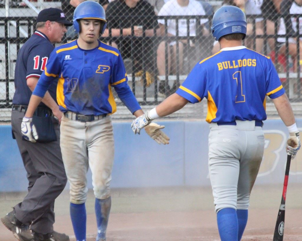 Piedmont's Peyton Whitten (L) is greeted by Taylor Hayes after scoring a run in the Bulldogs' 3A quarterfinal loss to Winfield Saturday. (Photo courtesy of Shannon Fagan/Cherokee County Herald)