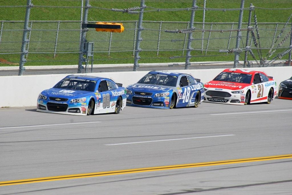 Dale Earnhardt Jr. (88) leads Jimmie Johnson (48) and Ryan Blaney late in the Geico 500.
