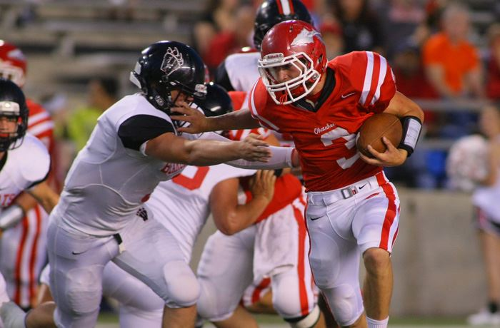 Ohatchee's Austin Tucker (3) fends off a Weaver defender. On the cover, Weaver's Malik Arnold celebrates scoring the game's first touchdown. Below, Ohatchee quarterback Taylor Eubanks loses the handle in a pileup. (Photos by Greg McWilliams)