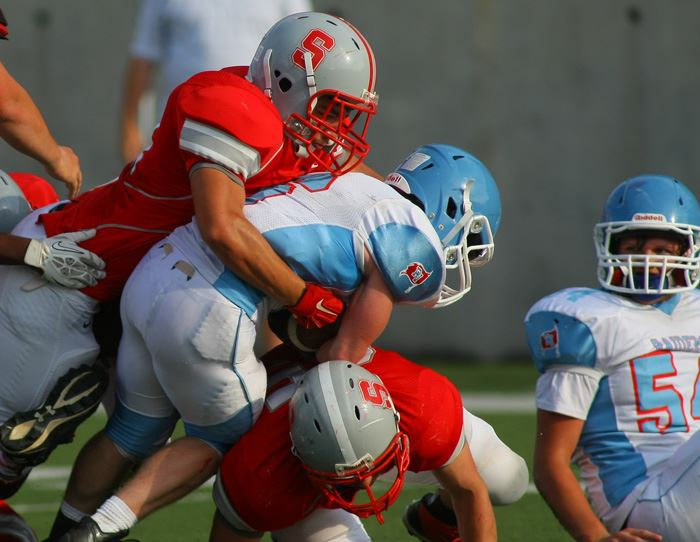 A Saks defender wraps up a Pleasant Valley ballcarrier during Friday's spring game. (Photo by Greg McWilliams)
