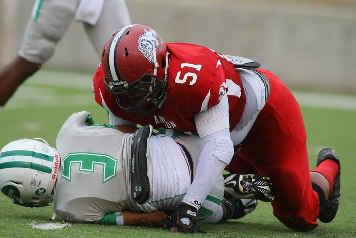Anniston's Elijah Jackson (51) gets the drop on Leeds' Tyler Rose. (Photo by Greg McWilliams)