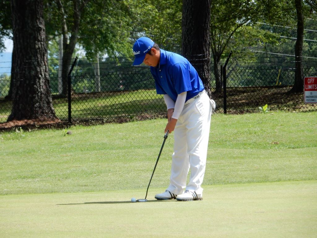 Andy Shim prepares to putt on the fifth green at Cane Creek Friday.