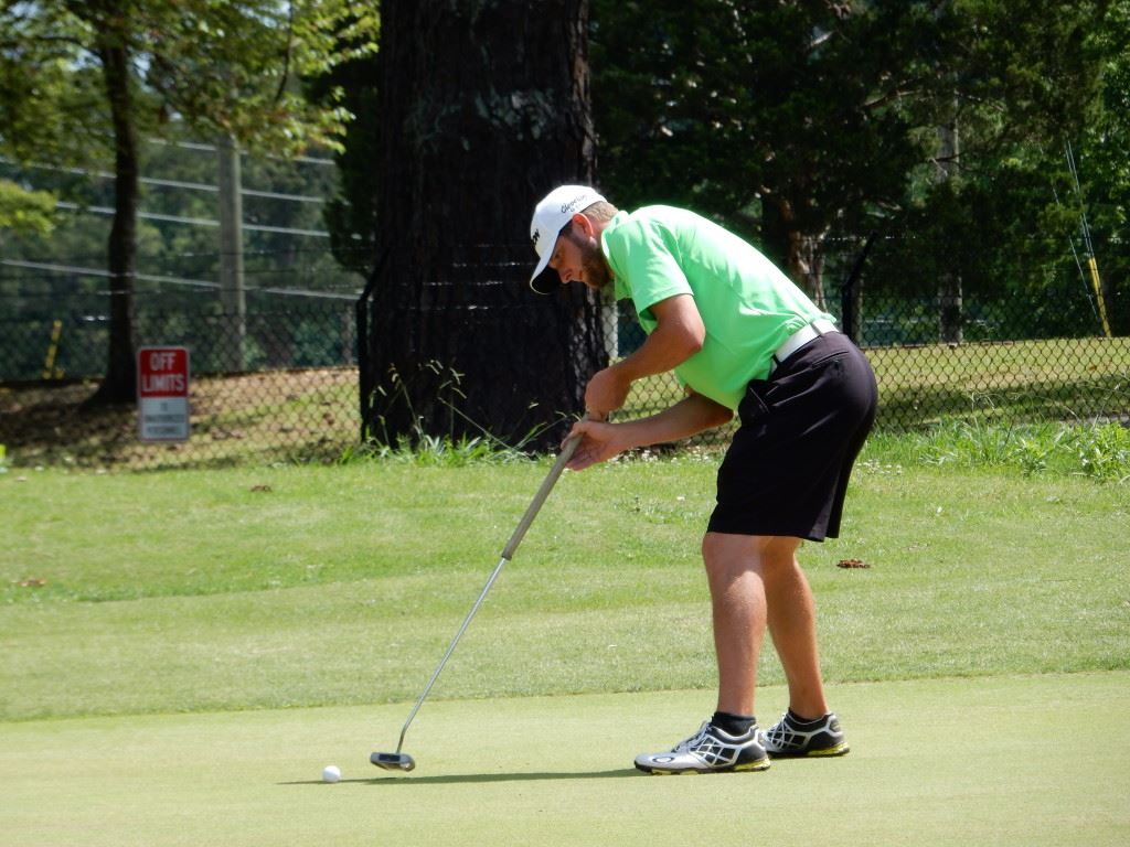 "First-round co-leader Kyle Sapp drops an eagle putt on the fifth green Friday. Sapp doesn't anchor his long putter, so he has no issue with that impending ban, but he said if the USGA ever made a rule regarding putter lengths, he'd cry foul as ""discrimination toward tall people."""