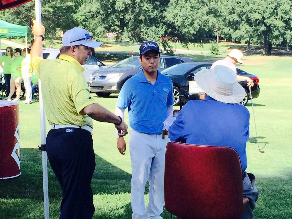 Andy Shim (C) visits with the starters prior to his round in the Fort McClellan Credit Union Pro-Invitational. Shim and second-round leader Kyle Sapp (cover) waged a back-and-forth battle early in the round.