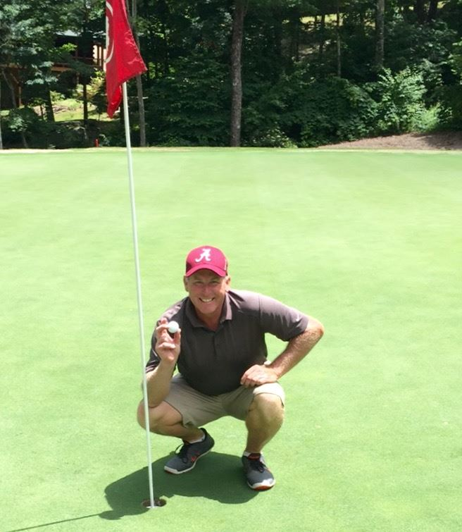 Kurt Duryea of Centre retrieves his hole-in-one at Canyon Ridge GC Saturday.