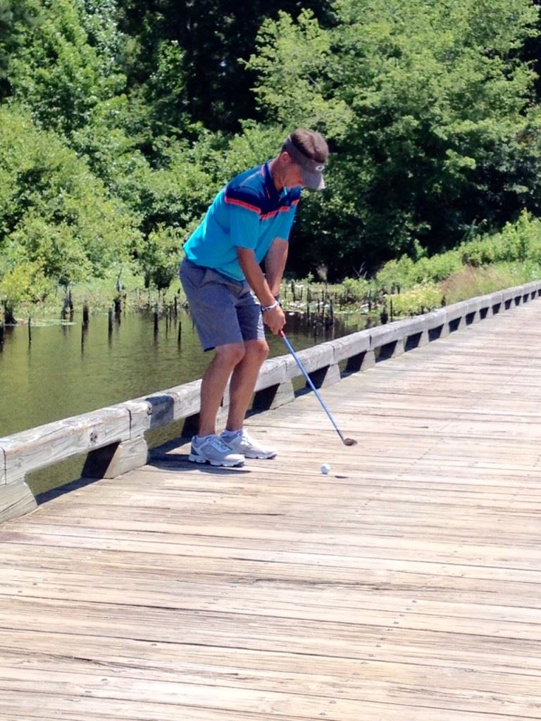 Jeremy McGatha hits a shot off the bridge on Backbreaker No. 6 at Silver Lakes. He made a double bogey on the hole,  but bounced back on the Heartbreaker nine to finish third overall. Ty Cole (cover) won by a stroke.
