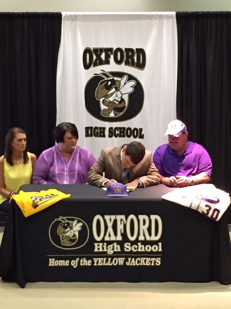 Oxford right-hander Mason Wilkins makes it official, signing his letters to play baseball at Miles College Wednesday. (Photo courtesy Oxford HS).