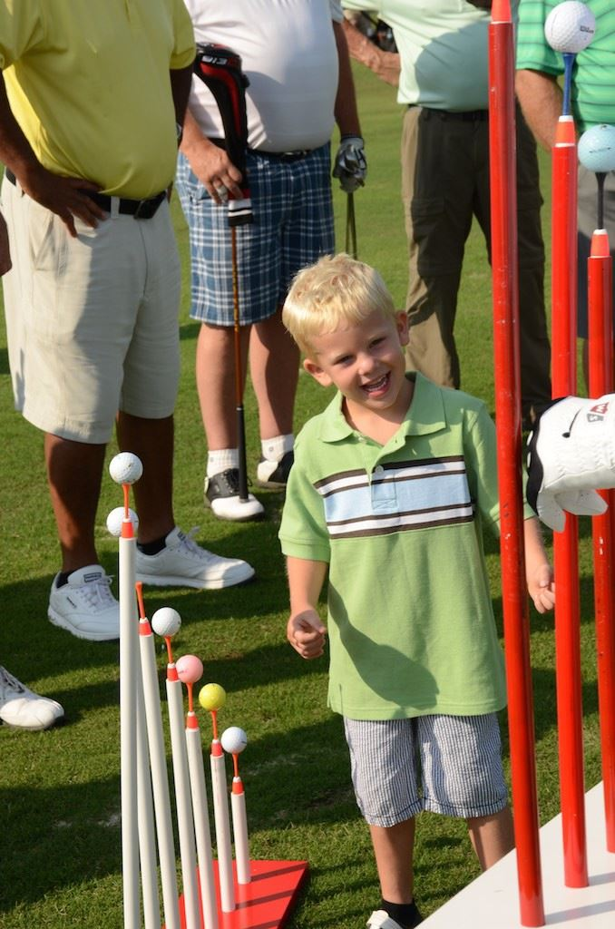 Five-year-old Conner Moore of Oxford is fascinated by the gadgets John Whitty uses during his trick-shot exhibitions. (Photo by B.J. Franklin)