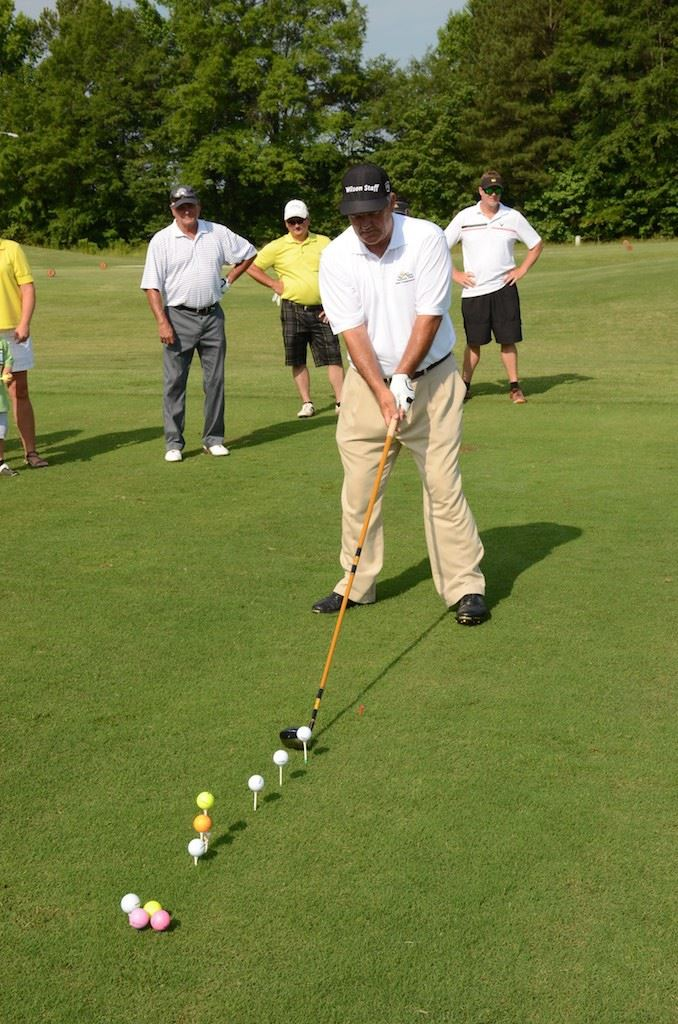 Myrtle Beach-area pro John Whitty hits shots with an extra-long driver during his trick-shot exhibition prior to the Oxford Senior Open Pro-Am Monday. (Photo by B.J. Franklin)