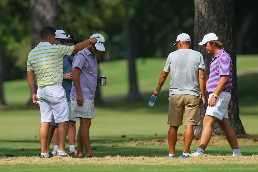 Spectators show Cole McNeal (R) the general vicinity where Dalton Chandler's (L) ball was resting before he hit the wrong ball on 17 Sunday. (Photo by Greg McWilliams)