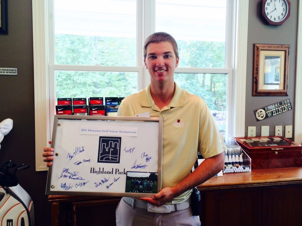 Cider Ridge intern John-Michael Russell displays the framed pin flag that commemorates his Honours Golf Intern Invitational victory. On the cover, Russell attends to daily business in the pro shop.