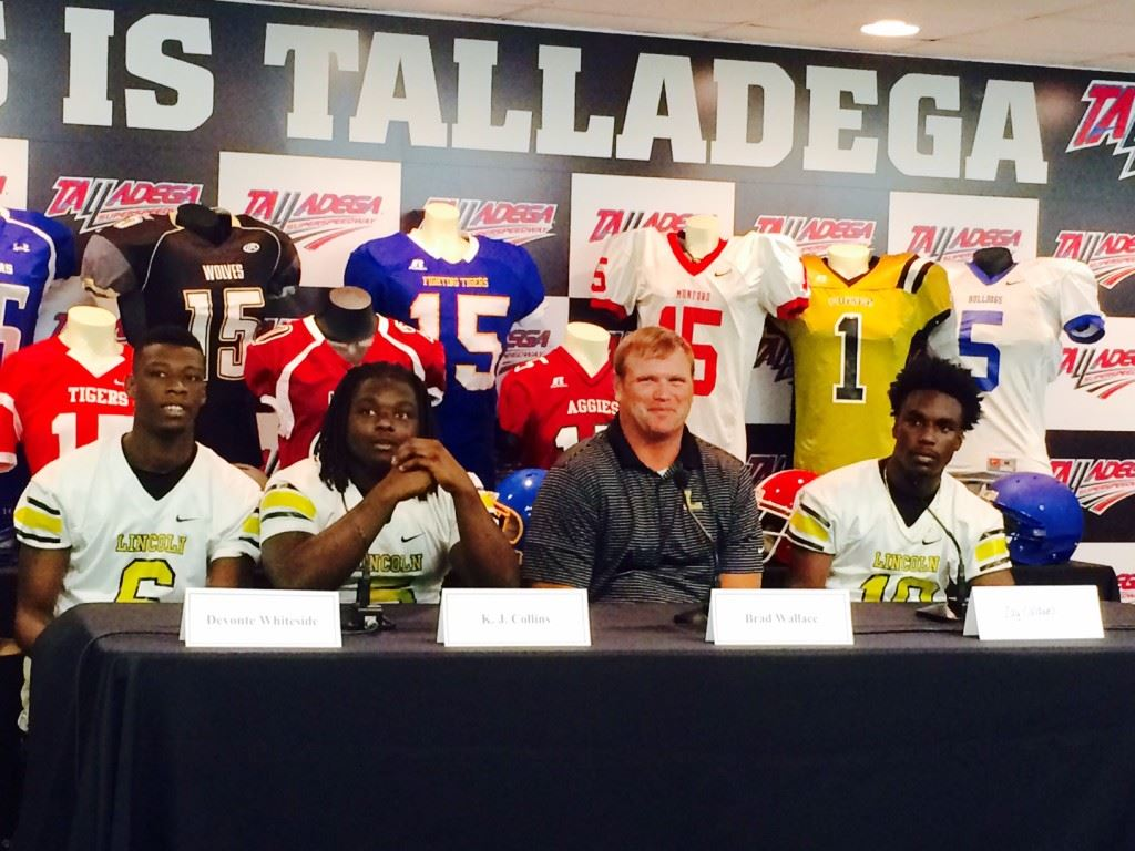 Lincoln's Devonte Whiteside, K.J. Collins, coach Brad Wallace and Zay Caldwell discuss the season ahead during Friday's Talladega County football media day. On the cover, Fayetteville's Darius Cook, Dustin Ingram, John Limbaugh and Luke Murphy talk about the team's community service efforts.