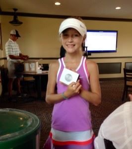 Erin Turley displays her second-place putting medal at Thursday's Drive, Chip & Putt subregional in Tennessee. On the cover, Turley awaits her turn to hit.
