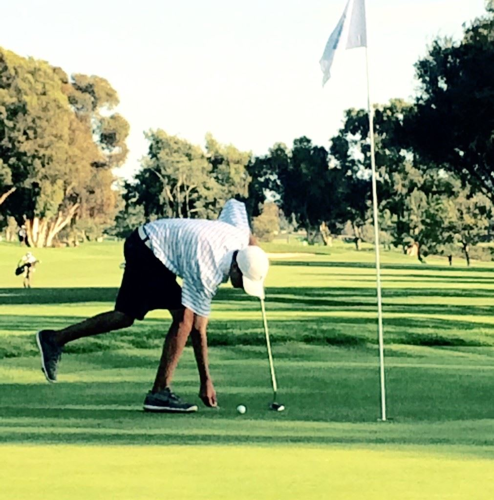 Jacob Lecroy returns his ball to its spot before knocking in a three-foot birdie putt on No. 6 at Torrey Pines Thursday. (Photo by Lewis Lecroy)