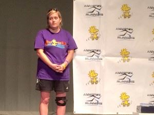 Race director Haley Gregg gets ready to address the runners during the awards ceremony of last year's Woodstock 5K.